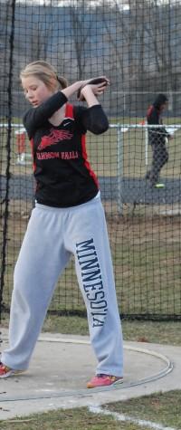 Karina Ritzman winds up for a discus toss